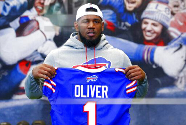 File-This April 27, 2019, file photo shows Buffalo Bills first round draft pick Ed Oliver posing for photographs following an NFL football news conference in Orchard Park N.Y.  Oliver was arrested Saturday, May 16, 2020, by police in the Houston area and charged with drunk driving and illegally carrying a gun. Montgomery County sheriff's deputies pulled Oliver over after receiving reports around 9 p.m. of someone driving recklessly in a construction area north of the city, local media outlets reported, citing jail and police records and statements from sheriff's officials. (AP Photo/Jeffrey T. Barnes, File)