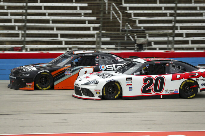 Jeb Burton (8) and Harrison Burton (20) come down the front stretch during a NASCAR Xfinity Series auto race at Texas Motor Speedway in Fort Worth, Texas, Saturday, Oct. 24, 2020. (AP Photo/Richard W. Rodriguez)
