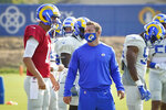 Los Angeles Rams head coach Sean McVay, center, talks to quarterback Jared Goff during an NFL football camp practice Wednesday, Aug. 19, 2020, in Thousand Oaks, Calif. (AP Photo/Marcio Jose Sanchez)