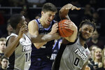 Villanova guard Collin Gillespie, center, fights for a rebound with Providence guard Alpha Diallo, left, and center Nate Watson, right, in the first half of an NCAA college basketball game, Saturday, Jan. 25, 2020, in Providence, R.I. (AP Photo/Elise Amendola)