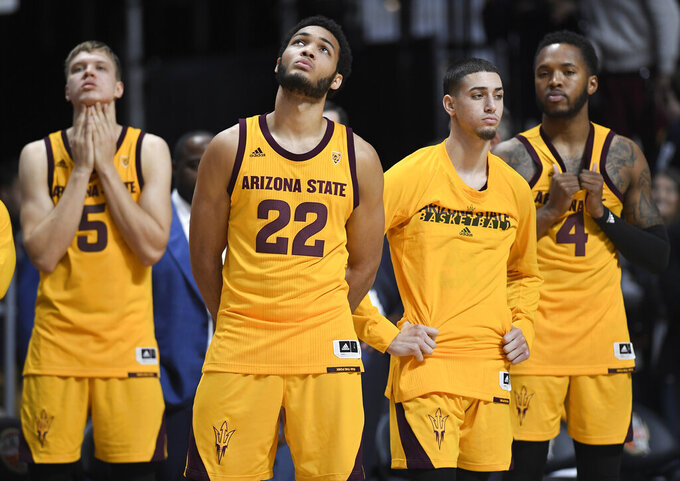 Arizona State players react from the bench at the end of an NCAA college basketball game against Virginia, Sunday, Nov. 24, 2019, in Uncasville, Conn. (AP Photo/Jessica Hill)