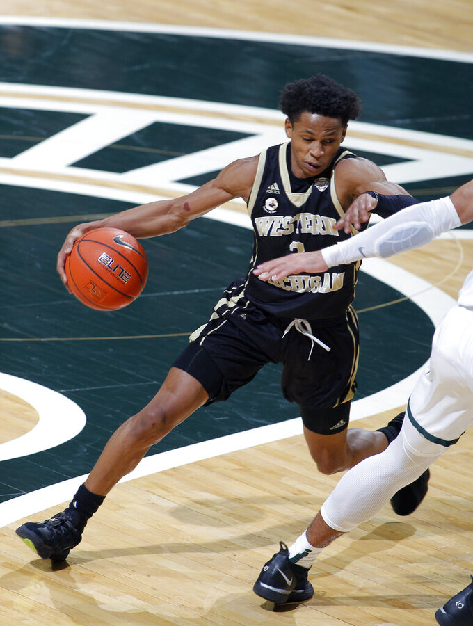 Western Michigan's B Artis White drives against Michigan State during the second half of an NCAA college basketball game, Sunday, Dec. 6, 2020, in East Lansing, Mich. (AP Photo/Al Goldis)