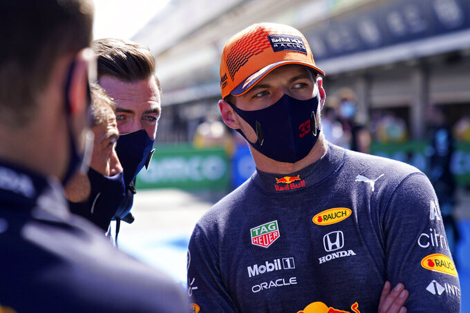 Red Bull driver Max Verstappen of the Netherlands talks with his team staff after he clocked the second fastest time in the qualifying for the Spanish Formula One Grand Prix at the Barcelona Catalunya racetrack in Montmelo, just outside Barcelona, Spain, Saturday, May 8, 2021. The Spanish Grand Prix will be held on Sunday. (AP Photo/Emilio Morenatti, Pool)