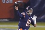 Chicago Bears' Mitchell Trubisky thorws a pass during the second half of an NFL football game against the Green Bay Packers Sunday, Jan. 3, 2021, in Chicago. (AP Photo/Nam Y. Huh)