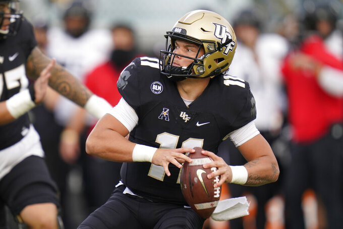 Central Florida quarterback Dillon Gabriel looks for a receiver during the first half of an NCAA college football game against Cincinnati, Saturday, Nov. 21, 2020, in Orlando, Fla. (AP Photo/John Raoux)