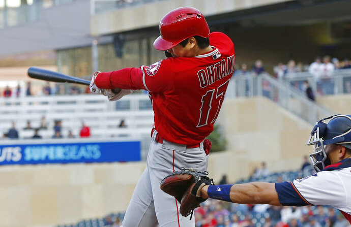 Los Angeles Angels Shohei Ohtani, of Japan, follows through on a two-run home run off Minnesota Twins pitcher Jose Berrios in the third inning of a baseball game Monday, May 13, 2019, in Minneapolis. (AP Photo/Jim Mone)