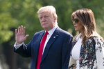 Without taking questions from reporters about the Mueller report, President Donald Trump and first lady Melania Trump walk to board Marine One for the short trip to Joint Base Andrews then on to his estate in Palm Beach, Fla., at the White House in Washington, Thursday, April 18, 2019.  (AP Photo/J. Scott Applewhite)