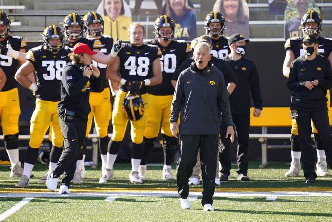 Iowa head coach Kirk Ferentz questions a call against his team during the first half of an NCAA college football game against Northwestern, Saturday, Oct. 31, 2020, in Iowa City, Iowa. (AP Photo/Charlie Neibergall)