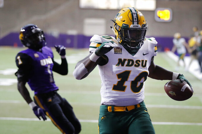North Dakota State running back Lance Dunn (10) celebrates in front of Northern Iowa defensive back Roosevelt Lawrence, left, after catching a 3-yard touchdown pass during the first half of an NCAA college football game, Saturday, Oct. 6, 2018, in Cedar Falls, Iowa. (AP Photo/Charlie Neibergall)
