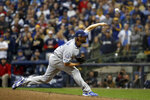 Los Angeles Dodgers starting pitcher Clayton Kershaw throws during the ninth inning of Game 7 of the National League Championship Series baseball game against the Milwaukee Brewers Saturday, Oct. 20, 2018, in Milwaukee. (AP Photo/Jeff Roberson)
