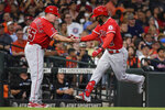 Los Angeles Angels' Luis Rengifo celebrates his two-run home run with third base coach Brian Butterfield during the third inning of a baseball game against the Houston Astros, Saturday, Sept. 11, 2021, in Houston. (AP Photo/Eric Christian Smith)
