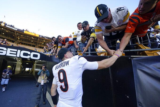 Cincinnati Bengals quarterback Joe Burrow (9) greets fans after defeating the Pittsburgh Steelers in an NFL football game, Sunday, Sept. 26, 2021, in Pittsburgh. The Bengals won 24-10. (AP Photo/Gene J. Puskar)
