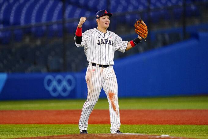 Japan's Munetaka Murakami celebrate after a semi-final baseball game against South Korea at the 2020 Summer Olympics, Wednesday, Aug. 4, 2021, in Yokohama, Japan. Japan won 5-2. (AP Photo/Matt Slocum)