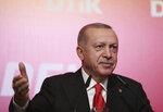Turkey's President Recep Tayyip Erdogan addresses the World Turkish Business Council meeting, in Baku, Azerbaijan, Monday. Oct. 14, 2019. Erdogan says Turkey's military offensive into northeast Syria is as