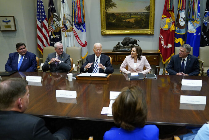 FILE - In this July 14, 2021, file photo President Joe Biden, center, speaks during a meeting with a bipartisan group of governors and mayors and cabinet officials in the Roosevelt room of the White House in Washington to discuss the bipartisan infrastructure deal in the Senate. Biden is flanked by New Jersey Gov. Phil Murphy, left, and Vice President Kamala Harris, right. (AP Photo/Susan Walsh, File)