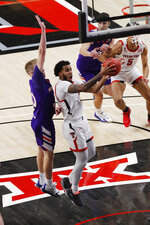 Texas Tech guard Kyler Edwards pulls in a rebound during the first half of the team's NCAA college basketball game against Northwestern State, Wednesday Nov. 25, 2020, in Lubbock, Texas. (AP Photo/Mark Rogers)
