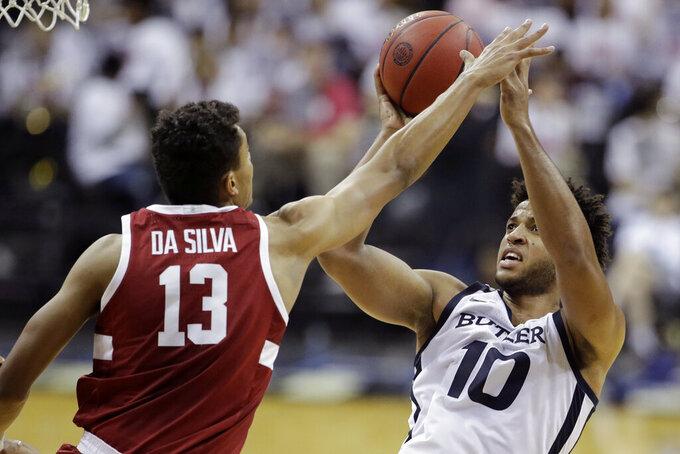 Butler forward Bryce Nze (10) shoots under pressure from Stanford forward Oscar da Silva (13) during the second half of an NCAA college basketball game, Tuesday, Nov. 26, 2019, in Kansas City, Mo. Butler won 68-67. (AP Photo/Charlie Riedel)