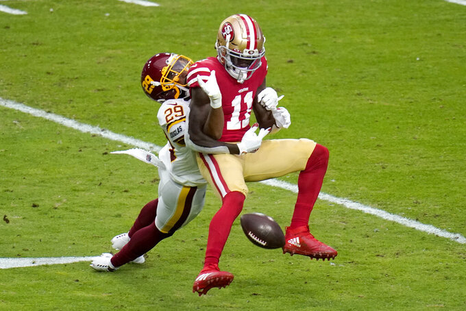 Washington Football Team cornerback Kendall Fuller (29) breaks up a pass intended for San Francisco 49ers wide receiver Brandon Aiyuk (11) during the first half of an NFL football game, Sunday, Dec. 13, 2020, in Glendale, Ariz. (AP Photo/Ross D. Franklin)