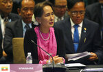 Myanmar leader Aung San Suu Kyi listens to speeches during the ASEAN Plus China Summit in the ongoing 33rd ASEAN Summit and Related Summits Wednesday, Nov. 14, 2018 in Singapore. (AP Photo/Bullit Marquez)