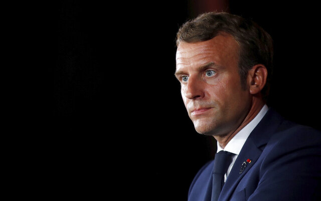 French President Emmanuel Macron arrives for a media conference in Beirut, Lebanon, Tuesday, Sept. 1, 2020. French President Emmanuel Macron issued a stern warning to Lebanon's political class, urging them to commit to serious reforms within few months or risk punitive action including sanctions, if they fail to deliver. (Gonzalo Fuentes/Pool via AP)