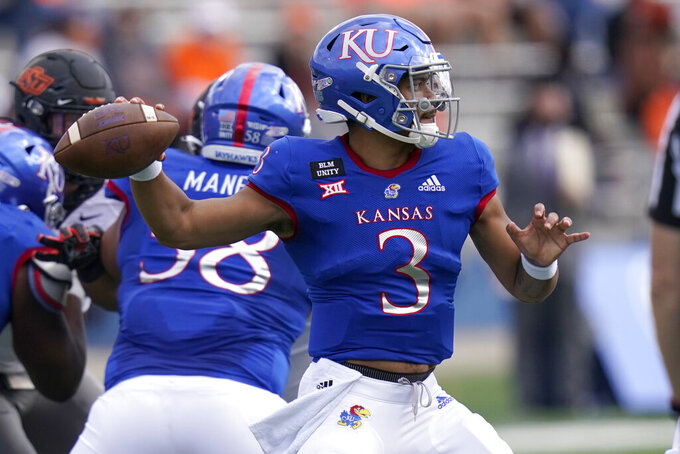 Kansas quarterback Miles Kendrick passes to a teammate during the first half of an NCAA college football game against Oklahoma State in Lawrence, Kan., Saturday, Oct. 3, 2020. (AP Photo/Orlin Wagner)