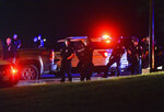 A heavy police presence is seen near an entrance of NorthPark Mall along West Kimberly Road Monday, June 1, 2020, in Davenport, Iowa. Two people are dead and a police officer was wounded in a round of rioting and violence that occurred Sunday night into Monday morning in Davenport.  (Meg McLaughlin/Quad City Times via AP)