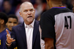 Denver Nuggets head coach Michael Malone talks with referee Bennie Adams (47) during the first half of an NBA preseason basketball game against the Phoenix Suns, Monday, Oct. 14, 2019, in Phoenix. (AP Photo/Matt York)