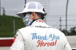 Kyle Busch wears a message to coronavirus pandemic responders on his back as he waits for the start of the NASCAR Xfinity series auto race Thursday, May 21, 2020, in Darlington, S.C. (AP Photo/Brynn Anderson)