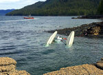 This May 13, 2019 photo provided by Ryan Sinkey, shows a Coast Guard Station Ketchikan response boat crew searching for survivors from a downed floatplane in the vicinity of George Inlet near Ketchikan, Alaska. Two floatplanes carrying cruise ship tourists collided Monday near the southeast Alaska town of Ketchikan.  (Ryan Sinkey via AP)