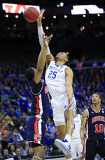Kentucky's PJ Washington (25) shots over Auburn's Horace Spencer during the first half of the Midwest Regional final game in the NCAA men's college basketball tournament Sunday, March 31, 2019, in Kansas City, Mo. (AP Photo/Orlin Wagner)
