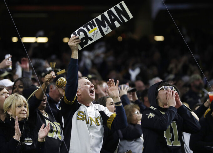 New Orleans Saints fans scream during the first half of the NFL football NFC championship game against the Los Angeles Rams, Sunday, Jan. 20, 2019, in New Orleans. (AP Photo/Gerald Herbert)