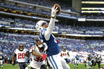 Indianapolis Colts' Eric Ebron (85) makes a touchdown catch against Houston Texans' Lonnie Johnson (32) during the second half of an NFL football game, Sunday, Oct. 20, 2019, in Indianapolis. (AP Photo/AJ Mast)