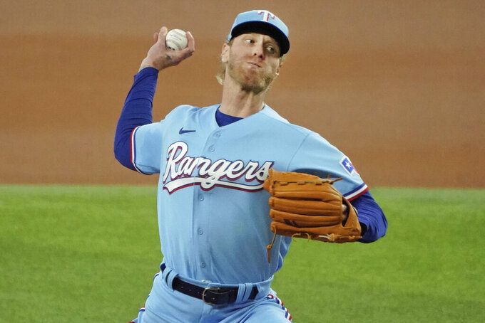 Texas Rangers starting pitcher Mike Foltynewicz throws against the Seattle Mariners in the first inning of a baseball game Sunday, Aug. 1, 2021, in Arlington, Texas. (AP Photo/Louis DeLuca)
