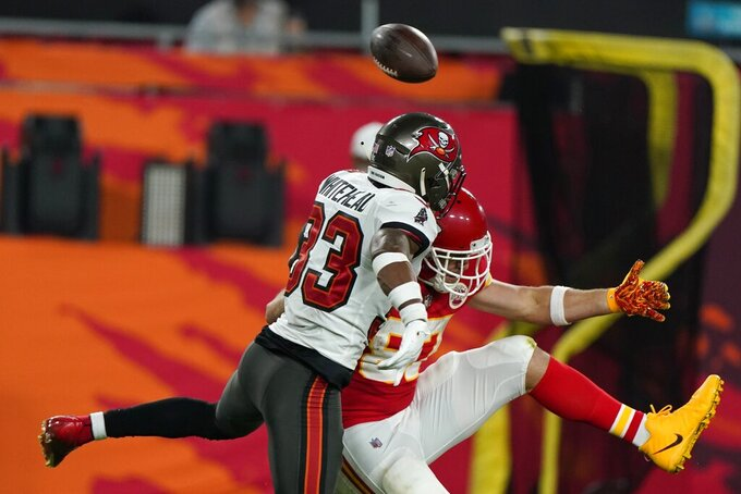 Tampa Bay Buccaneers free safety Jordan Whitehead, left, breaks up a pass intended for Kansas City Chiefs tight end Travis Kelce during the second half of the NFL Super Bowl 55 football game Sunday, Feb. 7, 2021, in Tampa, Fla. (AP Photo/Gregory Bull)