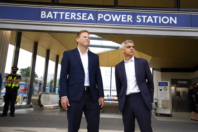 Mayor of London Sadiq Khan, right and Transport Secretary Grant Shapps pose for a photo at the newly opened Battersea Power Station London Underground station, in south London, Monday, Sept. 20, 2021. London's subway has opened two new stations in the network's first expansion since the 1990s. It's an expansion that Mayor Sadiq Khan said will play a key role in the capital's recovery from the pandemic. The two new Northern Line stations are at the Battersea Power Station and Nine Elms, both south of the River Thames and in areas of southwest London that have seen massive building and regeneration work in recent years. (David Mirzeoff/PA via AP)