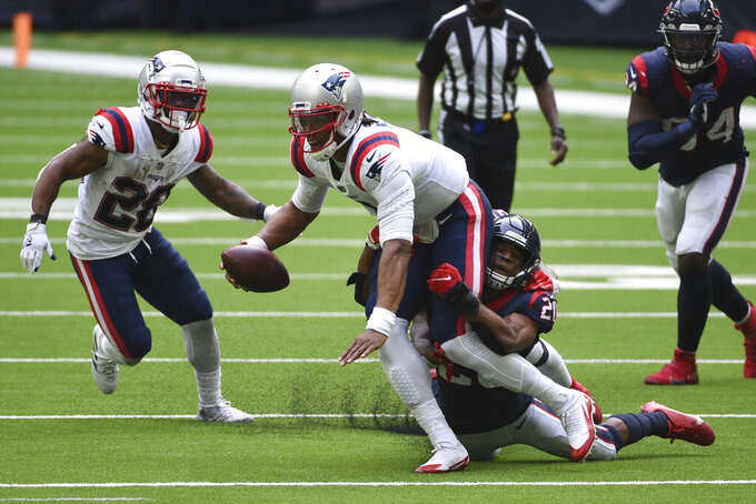 New England Patriots quarterback Cam Newton (1) is wrapped up by Houston Texans strong safety Justin Reid (20) during the second half of an NFL football game, Sunday, Nov. 22, 2020, in Houston. (AP Photo/Eric Christian Smith)