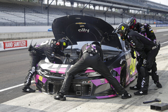 The crew for Justin Allgaier works on the car on a pit stop during a NASCAR Cup Series auto race at Indianapolis Motor Speedway in Indianapolis, Sunday, July 5, 2020. (AP Photo/Darron Cummings)