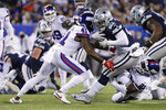 Dallas Cowboys running back Ezekiel Elliott (21) is tackled by New York Giants free safety Antoine Bethea (41) during the first quarter of an NFL football game, Monday, Nov. 4, 2019, in East Rutherford, N.J. (AP Photo/Adam Hunger)
