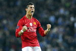 FILE - In this April 15, 2009, file photo, Manchester United's Cristiano Ronaldo reacts after his team's victory over FC Porto in a Champions League quarterfinal second leg soccer match,at the Dragao stadium in Porto, Portugal. Ronaldo is headed back to Manchester United. The English club said Friday, Aug. 27, 2021, it has reached an agreement with Juventus for the transfer of the 36-year-old Portugal forward, subject to agreement of personal terms, visa and a medical examination. (AP Photo/Paulo Duarte, File)