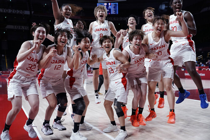 Japan players celebrate their win over France in a women's semifinal basketball game at the 2020 Summer Olympics, Friday, Aug. 6, 2021, in Saitama, Japan. (AP Photo/Eric Gay)