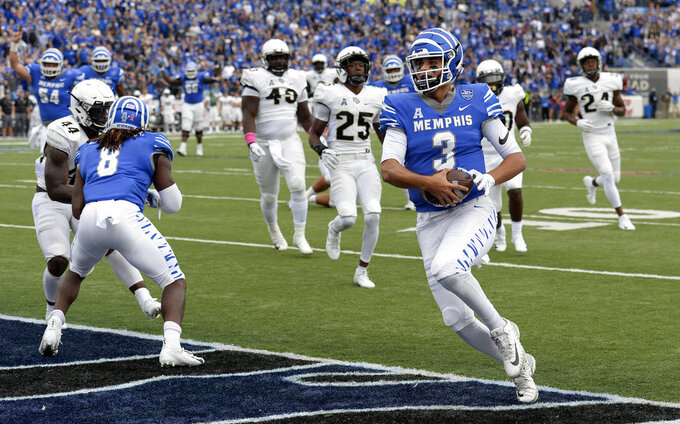 Memphis quarterback Brady White (3) scores a touchdown on a 11-yard run against Central Florida during the first half of an NCAA college football game Saturday, Oct. 13, 2018, in Memphis, Tenn. (AP Photo/Mark Zaleski)