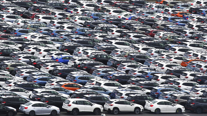 In this July 8, 2019, photo, Subaru cars for export park at Kawasaki port, near Tokyo. Japan has recorded a trade surplus in October, the first surplus in four months, as exports to the U.S. fell and oil prices slipped, according to a report on Wednesday, Nov. 20, 2019. (AP Photo/Koji Sasahara)