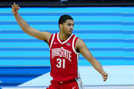 Ohio State forward Seth Towns (31) celebrates a basket against Purdue during overtime of an NCAA college basketball game at the Big Ten Conference tournament in Indianapolis, Friday, March 12, 2021. Ohio State defeated Purdue 87-78 in overtime. (AP Photo/Michael Conroy)