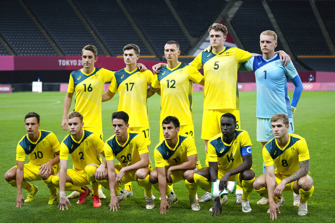Australia's Olympic soccer team poses for a team photo prior a men's soccer match against Spain at the 2020 Summer Olympics, Sunday, July 25, 2021, in Sapporo, Sapporo, Japan. (AP Photo/)