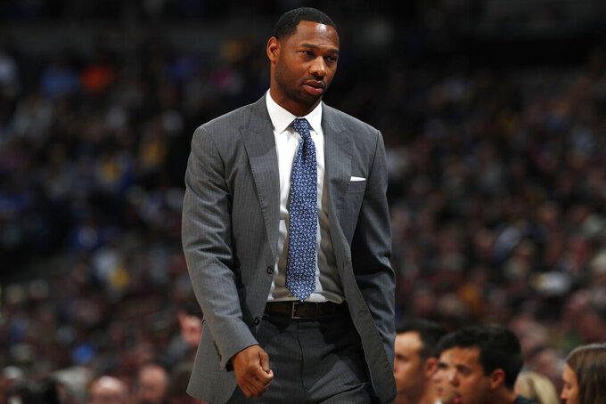FILE - Phoenix Suns assistant coach Willie Green is shown during the second half of an NBA basketball game in Denver, in this Sunday, Nov. 24, 2019, file photo. A person familiar with the situation says the New Orleans Pelicans are negotiating with Suns assistant Willie Green about taking over as head coach but no deal is in place and discussions could extend beyond the NBA Finals. The person spoke to The Associated Press on condition of anonymity because talks were ongoing and the Pelicans have not publicly discussed coaching candidates. (AP Photo/David Zalubowski, File)