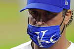 Kansas City Royals manager Mike Matheny walks back to the dugout after making a pitching change during the sixth inning of a baseball game against the St. Louis Cardinals Wednesday, Sept. 23, 2020, in Kansas City, Mo. (AP Photo/Charlie Riedel)