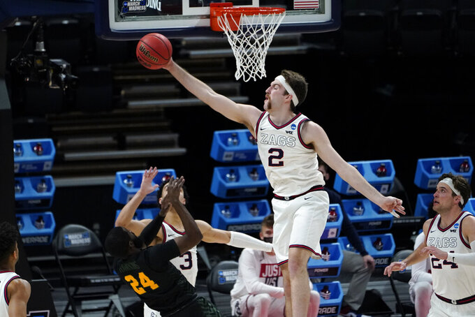 Gonzaga forward Drew Timme (2) blocks a Norfolk State guard Jalen Hawkins (24) shot during the first half of a men's college basketball game in the first round of the NCAA tournament at Bankers Life Fieldhouse in Indianapolis, Saturday, March 20, 2021. (AP Photo/Paul Sancya)
