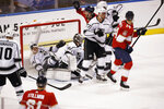 Los Angeles Kings left wing Nikolai Prokhorkin (74) and goaltender Jack Campbell (36) defend the goal against Florida Panthers left wing Mike Hoffman (68) during the first period of an NHL hockey game Thursday, Jan. 16, 2020, in Sunrise, Fla. (AP Photo/Brynn Anderson)