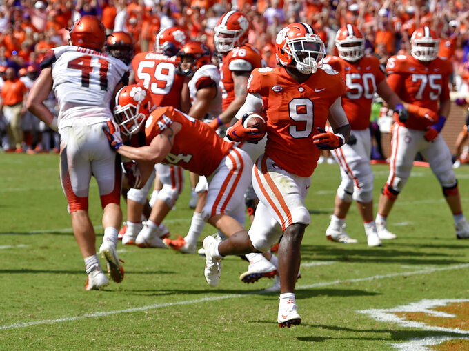 Clemson's Travis Etienne scores the winning touchdown in the second half of an NCAA college football game against Syracuse Saturday, Sept. 29, 2018, in Clemson, S.C. Clemson won 27-23. (AP Photo/Richard Shiro)