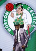 Indiana's Romeo Langford leaves the stage after the Boston Celtics selected him as the 14th pick overall in the NBA basketball draft Thursday, June 20, 2019, in New York. (AP Photo/Julio Cortez)